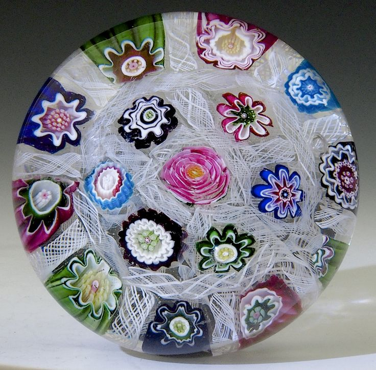 """Clichy {France} paperweight - Chequer upset muslin with 17 lovely canes including famous Clichy rose. 1846-50, 3 1/8""""w x 2 1/4""""t, 23.8 oz. - # 0617"""