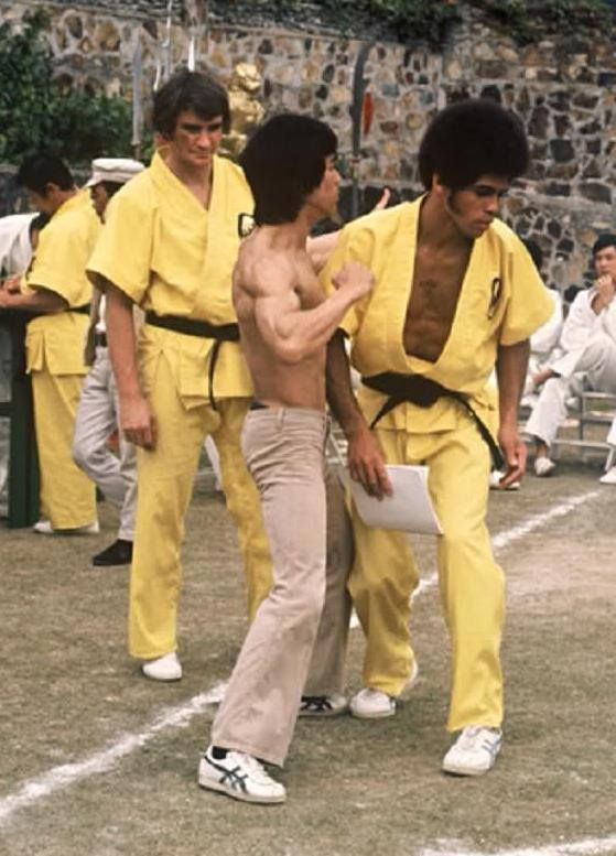"Jim Kelly and Bruce Lee working on the set of ""Enter the Dragon."""