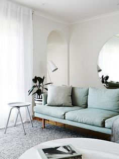 pale blue sofa | modern living room with white walls and curtains | nail the trend with an IKEA Söderhamn sofa and a Bemz slipcover