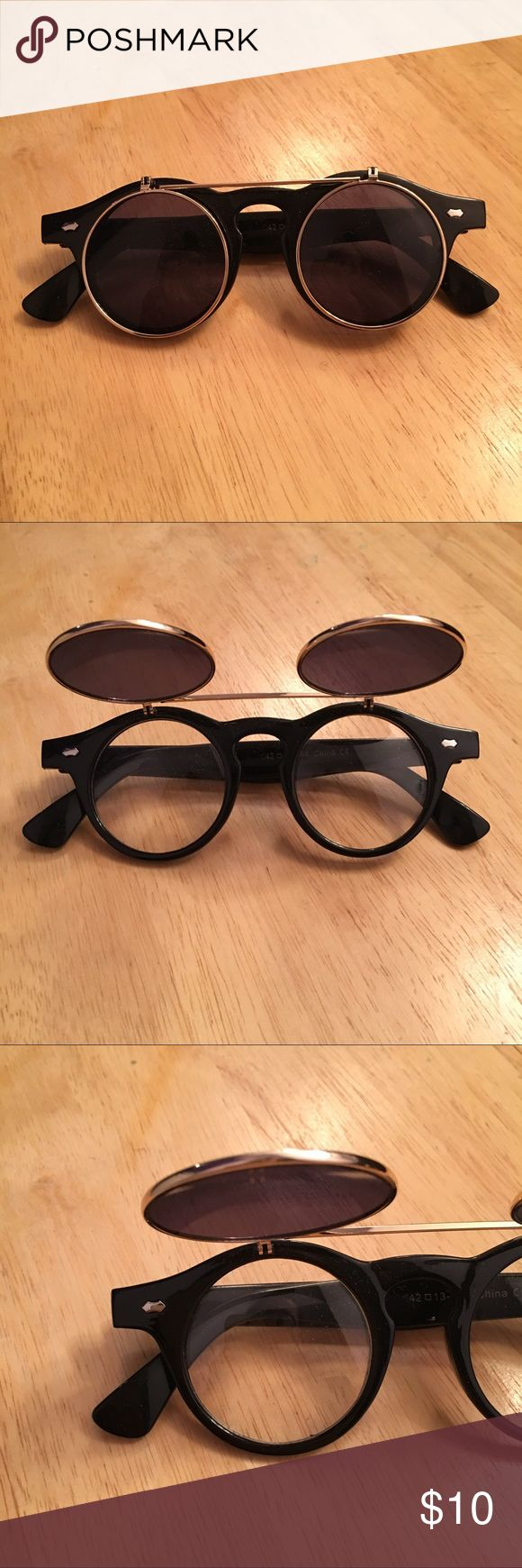 Flip up sunglasses Sunglasses: -Sunglasses part flip up -clear glasses underneath  -Only wore a couple times -perfect condition  -Was an impulse buy, I don't need!!  Any questions, just ask!! 💞💞 ***MAKE AN OFFER!!*** Other Accessories Sunglasses
