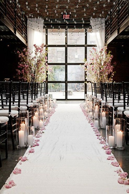 String lights overhead and blooming branches make for one whimsical aisle we couldn't love more. For endless inspiration and decor ideas, indulge in a gallery of our favorite wedding aisles.