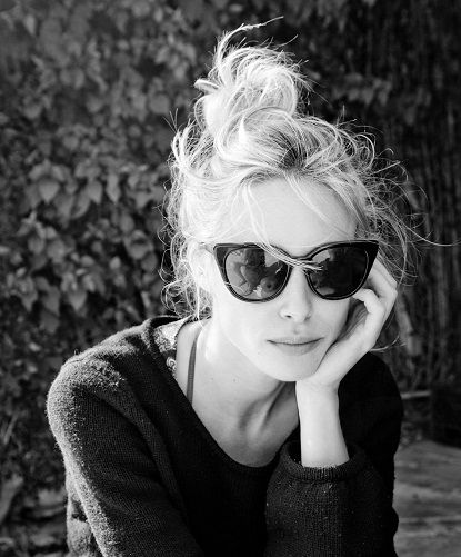 cat-eye sunglasses + messy top knot.