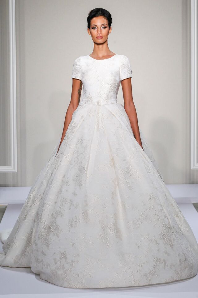 Bridal fashion week dennis basso fashion weeks short for Kleinfeld wedding dresses with sleeves