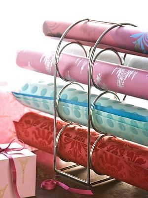Love how she used a wine rack to store wrapping paper.  However, you'd have to have 2 of the same racks to make it work.