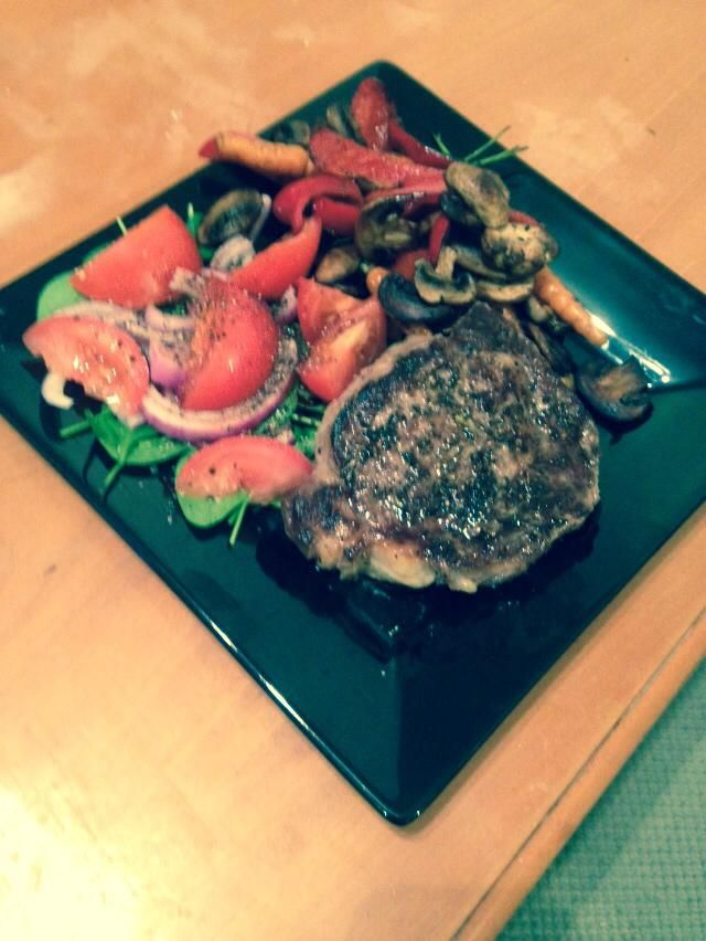 Peppered scotch fillet with sautéed mushrooms  a garden salad