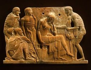 """Terracotta plaque, ca. 460-450 BC, artist unknown The Metropolitan Museum of Art, Fletcher Fund, 1930 (30.11.9) Image © The Metropolitan Museum of Art. From the description from the Metropolitan Museum website: """"Odysseus returning to Penelope....Here [Odysseus] is shown approaching the disconsolate Penelope, as the faithful members of his household—his father, Laertes, his son, Telemachos, and the swineherd Eumaios—look on."""""""
