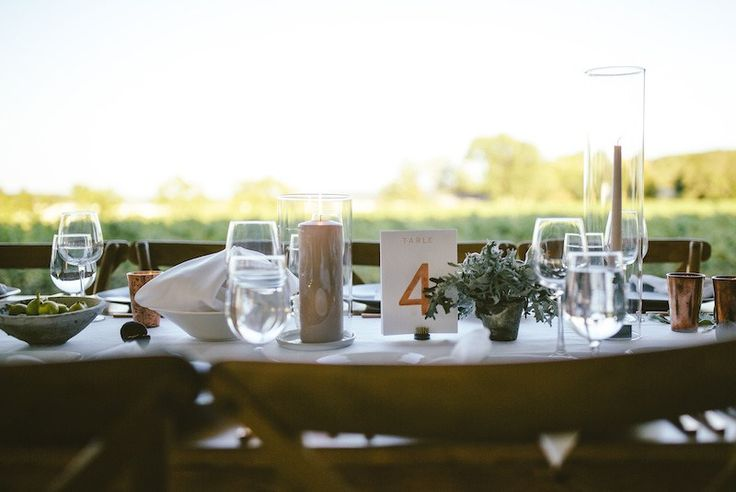 Rose Gold Table Numbers by Bon Paper House Sweet Woodruff Centerpiece Greenery Tuscan Figs Planning by Lu Parkinson Candles Votives Tablescape   Ravine Vineyard Estate Winery Wedding   Bon Paper House   Photos by Kieran Darcy