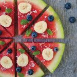 A no-bake pizza! Watermelon substitutes for crust, bananas replace pepperoni, and coconut flakes stand in for cheese. This perfect summer #recipe is easy, light and low fat.