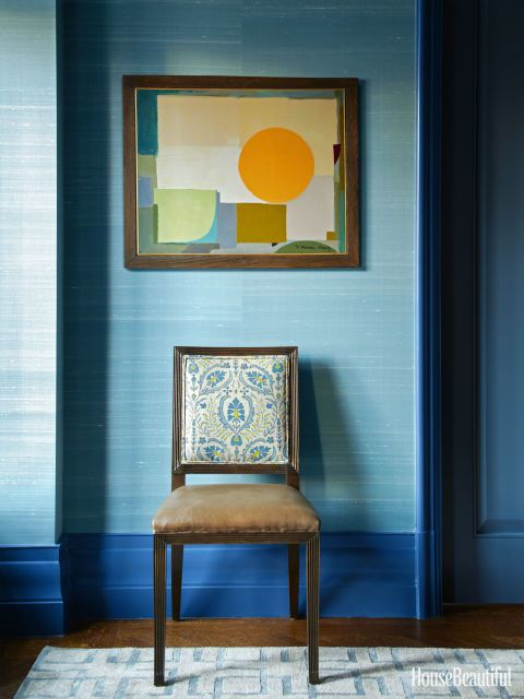 Tall baseboards outline the room and set off walls in Solstice silk by Phillip Jeffries.