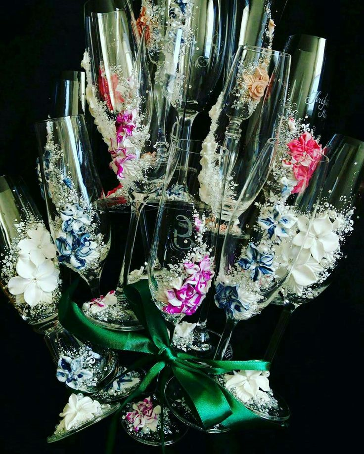 Colorful decorated wedding glasses wedding bouquet of