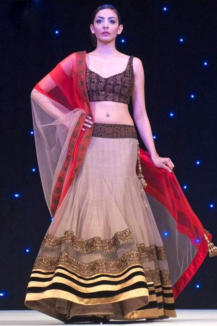 Bollywood Replica-Designer Beige & Brown Net Lehenga Choli  PRODUCT DETAILS :  Style : Semi Stitched Designer Lehenga Choli Colour : Beige & Brown Lehenga Fabric : Net Blouse Fabric : Art Silk With Embroidery Inner Fabric : Santoon Dupatta Fabric : Net with Red Lace Border Work Work : Embroidered Blouse , Border Work Occasion : Party, Wedding, Ceremony, Festival Price : 2750/- For Order whatsapp us at +91-9311187463 or you can also Visit our website : http://www.suit-sarees.com