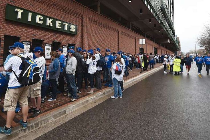 Cubs raise World Series banner at Wrigley:     Fans wait in line for tickets to the home opening game between the Cubs and Dodgers at Wrigley Field.  -  April 10, 2017