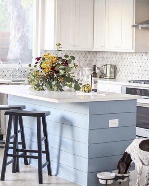 The kitchen of @deborahstachelski is pure design inspiration. We especially love the horizontal blue clapboard on the island! #mypotterybarn #kitchengoals