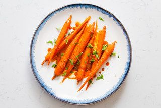 The Fast, French Trick to Giving Vegetables Slow-Cooked Flavor  Carrot juice glazed carrots with ginger on plate / Photo by Chelsea Kyle, food styling by Rhoda Boone
