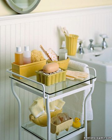 Mustard yellow vintage planters hold soaps, lotions, wash cloths, even toothbrush...unique idea