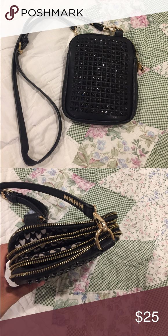 Super cute purse ‼️ Black studded purse, with 3 different zipper pockets. Fits everything you could possibly need. Perfect for traveling! Pink Cosmo Other