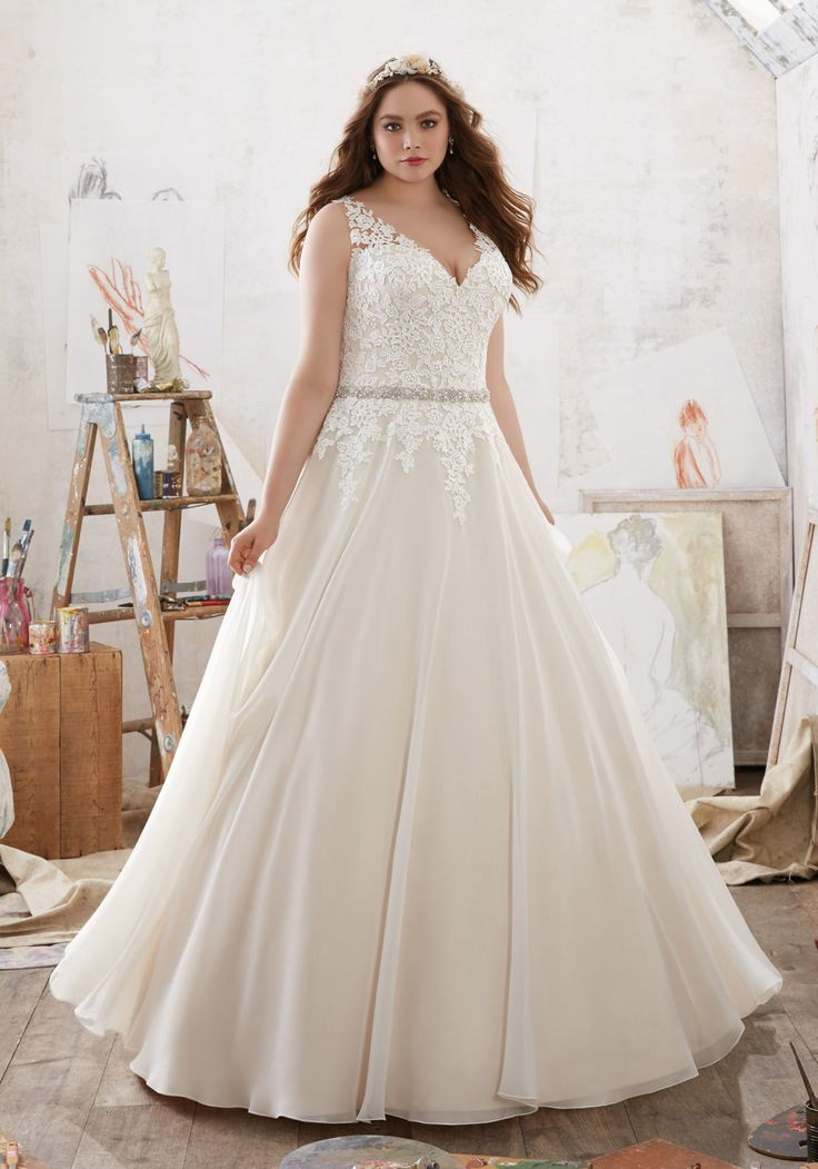 Popular Designer Wedding Dresses and Bridal Gowns by Morilee This Plus Size Wedding Dress features Frosted Lace Appliqu s on the Bodice on Beautiful Chiffon