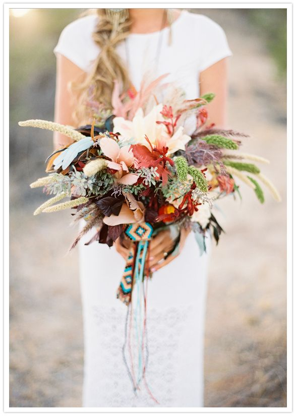 feather and floral southwestern inspired bouquet