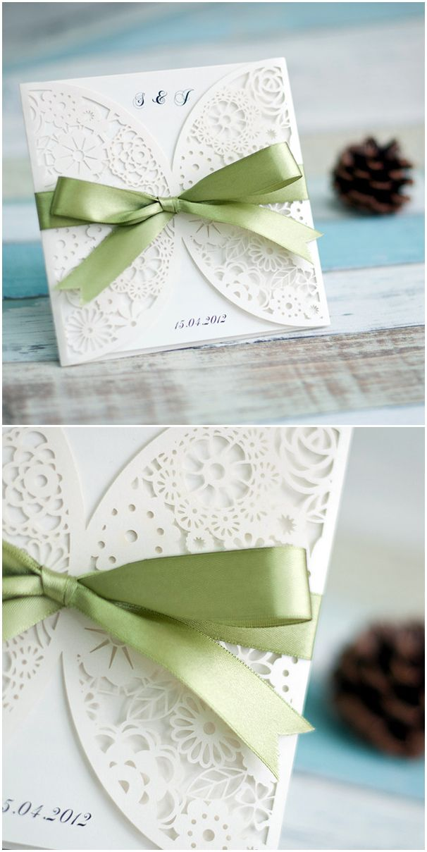 elegant ivory laser cut wedding invitations with sage green ribbon