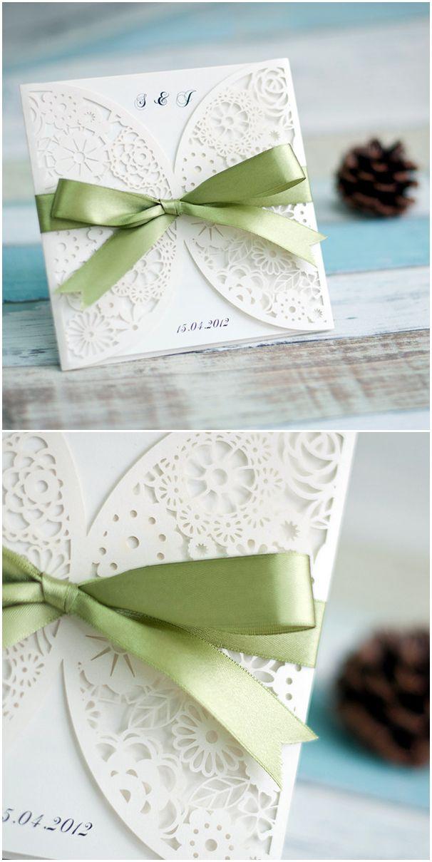 elegant ivory laser cut wedding invitations with sage green ribbon