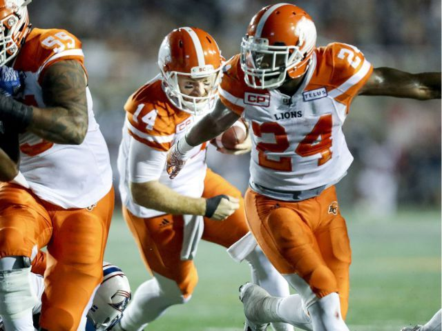 Week 3 - July 6 2017 - BC.23 - MTL. 16 -  British Columbia Lions quarterback Travis Lulay follows the block by running back Jermiah Johnson, right, for the winning touchdown during fourth quarter of Canadian Football League game against the Alouettes in Montreal Thursday July 6, 2017.  JOHN MAHONEY/MONTREAL GAZETTE