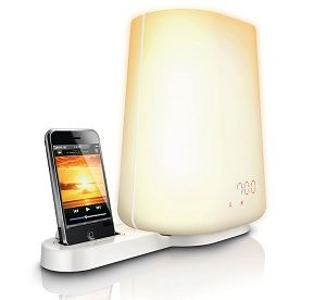 I need this. alarms make me grumpy in the morning  :/ Ditch those annoying buzzing, vibrating, and ringing alarm clocks. You can now wake up naturally with this gradually increasing Wake Up Light alarm clock that also serves as an iPod dock to play your favorite music as you slowly wake up.