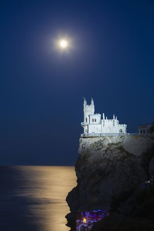 Ukraine, Crimea, Full Moon Shines over the Swallow's Nest Castle Perched on Aurora Clff