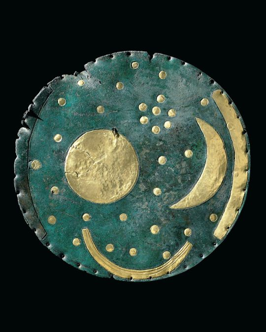 "1600 B.C.: Nebra Sky Disk. Himmelsscheibe von Nebra, Mittelberg near Nebra, Germany. Authorized copy. The oldest representation of the sky. ©LDA Sachsen Anhalt Foto Juraj Liptak.  Exhibition ""Heavenly bodies"", Pforzheim Jewellery Museum, Germany, 08.07. – 30.10.2016."