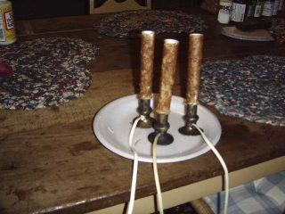 Using glue and instand coffee or ground spices to give electric candles an older and more primitive look
