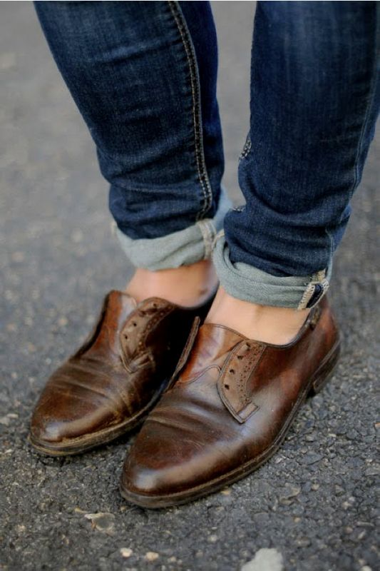 worn in old leather oxfords and jeans