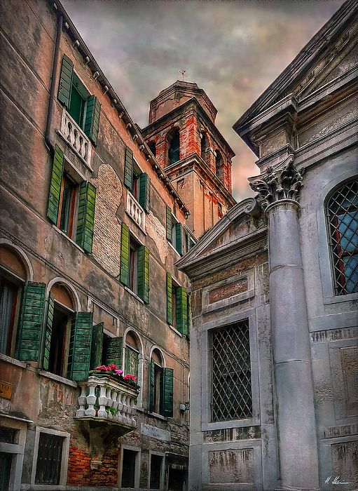 Arcadian scenic view of old venetian buildings on Calle Bergami S. Croce at…