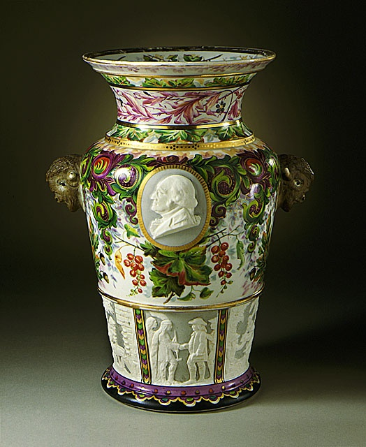 Union Porcelain Works (United States, New York, Greenpoint, 1862 - 1922)   Century Vase, circa 1876  Decorative Arts Acquisition Fund and Museum Acquisition Fund (M.87.3).    On the one-hundredth anniversary of America's independence – in 1876 – there were celebrations all across America, and lots of souvenirs. This was one of them; a centennial porcelain vase. It was a popular, mass-produced item that middle-class people could afford.