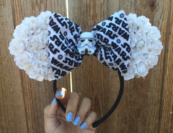 Handmade floral ears ^.^ Large white flowers finished with Star Wars Print bow and storm trooper button   One size fits all   *THESE WILL BE SENT OUT AUG 12-15*