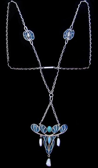 This is not contemporary - image from a gallery of vintage and/or antique objects. LEVINGER & BISSINGER  A silver plique-a-jour necklace with plique-a-jour spacers. The central pendant  set with turquoise and with pearl drops.
