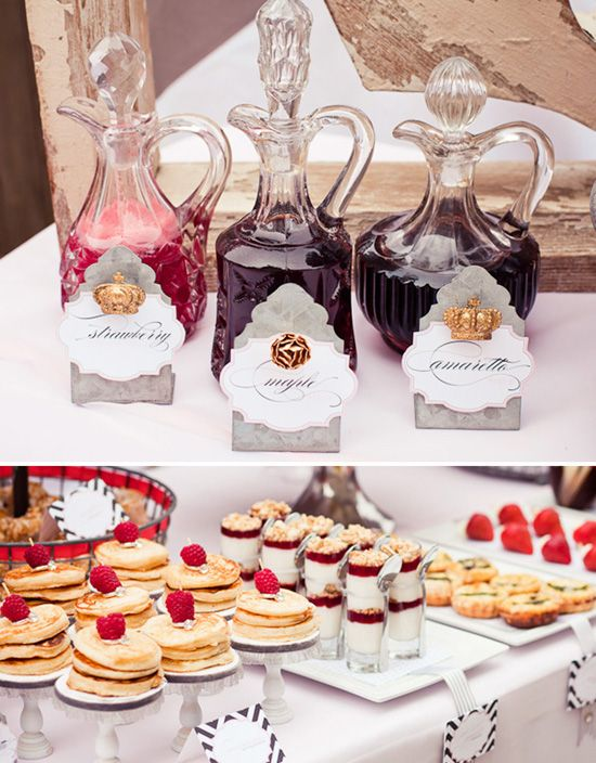 fancy bottles for syrup & silver dollar pancakes topped with a berry & held together with a toothpick bridal shower brunch idea
