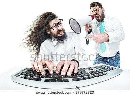 Angry boss yelling to a stressed office worker - Shutterstock Premier