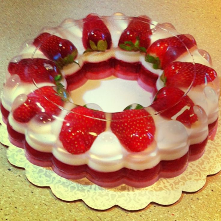 Strawberry gelatin (picture only) How I would make this...bottom layer strawberry jello, white later plain gelatin with sweetened condensed milk, top layer plain gelatin with whole strawberries