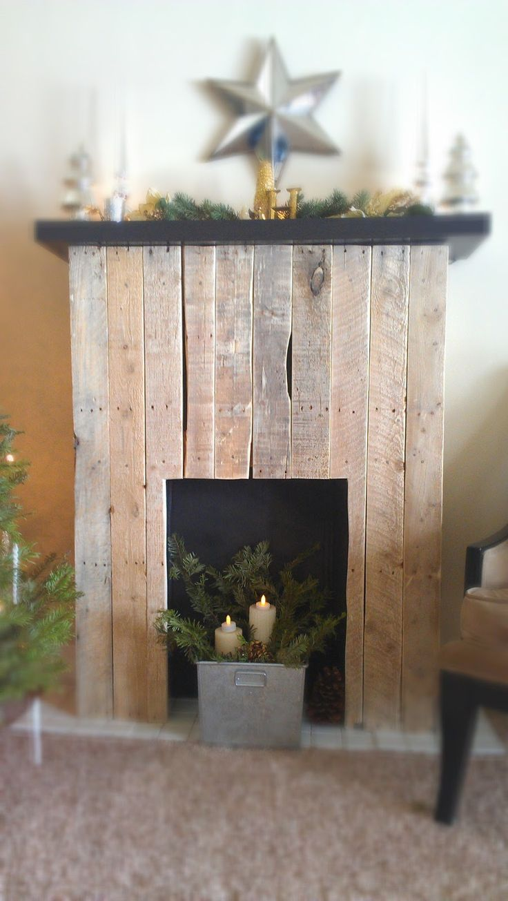 Faux fireplace. Upcycled ~ Recycled Pallet wood into fire place. Awesome idea for reclaimed wood or barnwood.