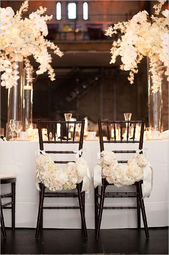 Elegant black and white wedding ideas: Floral chair decor @weddingchicks