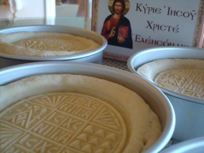 Baking prosphora -- small loaves of leavened bread offered at the Divine Liturgy (Eucharist).  Visit http://myocn.net/ for more Orthodox Christian news!