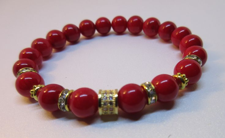 Natural Bamboo Coral Stretch Bracelet with CZ  Pave Gold  Column Bead . Want to be protected against negative influences this is the bracelet to have.