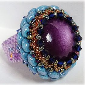 I'd love to figure out the technique used to bezel the focal bead and create earrings or make several to use for a bracelet or incorporate into a necklace!