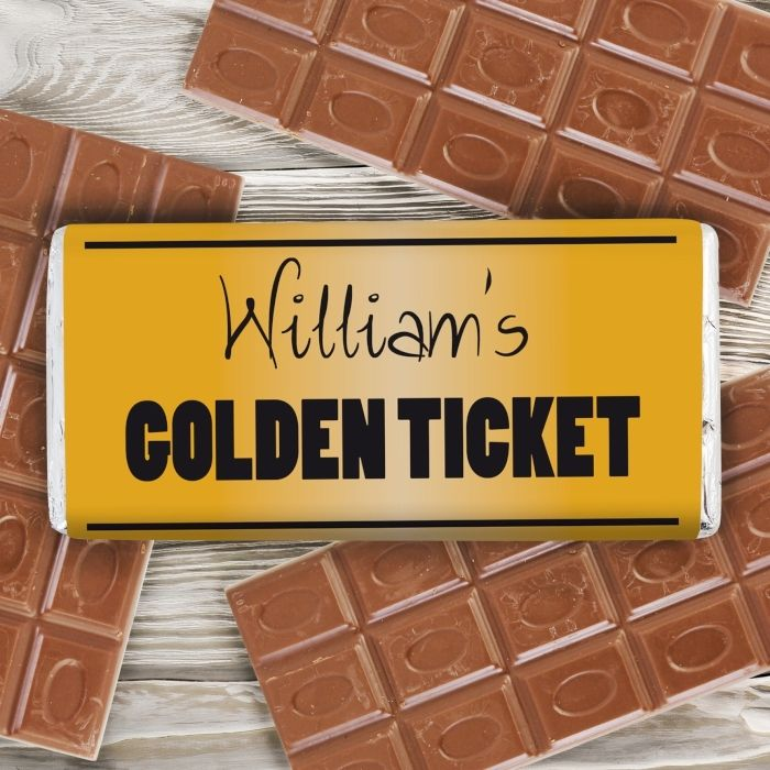 This quirky milk chocolate bar makes the perfect unique gift for any chocolate lover!  The chocolate bar can be personalised on the front with any name up to 15 characters and any message on the reverse over 2 lines and up to 30 characters per line. The wording 'Golden Ticket' is standard text. Please include 's.  Perfect for inviting guests to a special event!  Milk Chocolate Bar 15cm x 7cm x 1cm Weight 100g May contain traces of nuts  Our great value chocolate includes free standard…