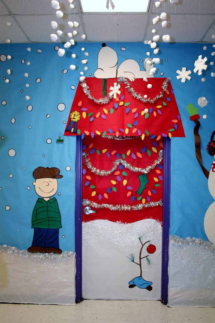 This Charlie Brown and Snoopy Christmas classroom door display is adorable.