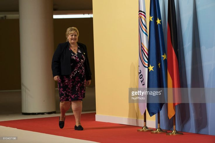 Norway's Prime Minister Erna Solberg arrives to be welcomed from German Chancellor Angela Merkel (not in the picture) prior to a first meeting of G20 leaders at the Messe in Hamburg, Germany on July 7, 2017.