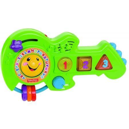 """Fisher Price Игрушка Обучающая гитара  — 1855р. ---------------- Игрушка """"Обучающая гитара"""" из серии """"Смейся и учись"""" Fisher-Priceмарки Mattel станет прекрасным подарком для вашего ребенка. Развивающая гитара поможет малышу изучать цвета и формы,буквы и числа, развивать зрительное и звуковое восприятие. Множество светящихся кнопок, три ярких колечка и светящаяся звездочка непременно порадуют малыша. В гитару встроено 25 разных мелодий и песенок, которым можно весело подпевать.Изображения…"""