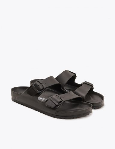 Slippers from Birkenstock. Made in one piece from ethylene vinyl acetate, a light weight, highly flexible and waterproof material. Two adjustable straps over the ankle with buckle closure.