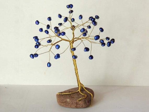 Check out this item in my Etsy shop https://www.etsy.com/listing/251427476/blue-freshwater-pearls-wire-treewire