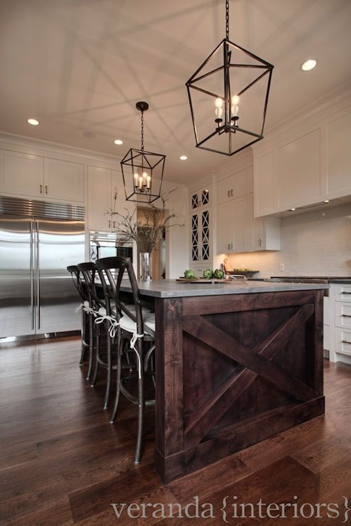 white cabinets, dark stained island & granite top, iron lanterns