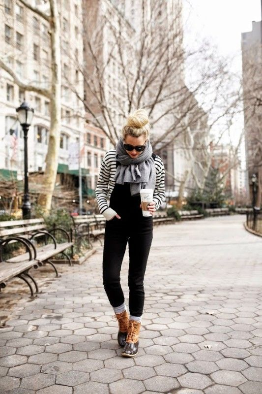 Blair Eadie from the fashion blog Atlantic Pacific wearing her duck boots. Convinced this is a look for all ages? We are.